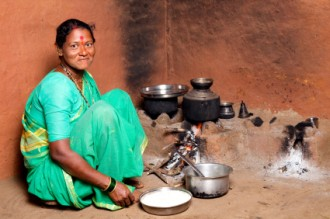 Rural Indian Woman cooking food in the Kitchen